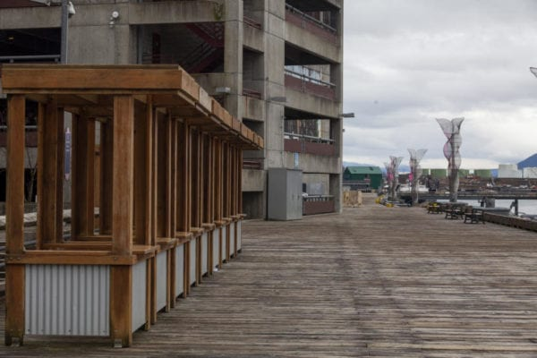 A board walk with some empty stalls nearby