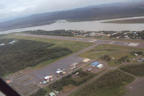 A small airport next to a river as seen from above